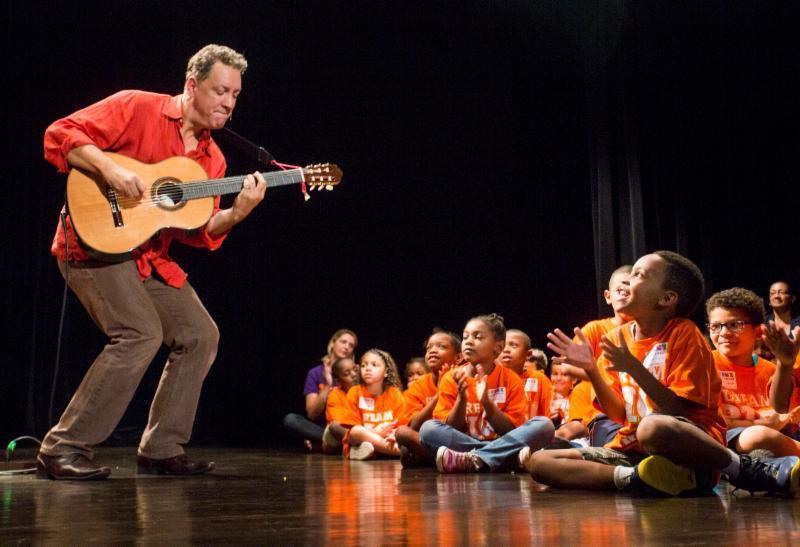 Performer David Gonzalez captivates students