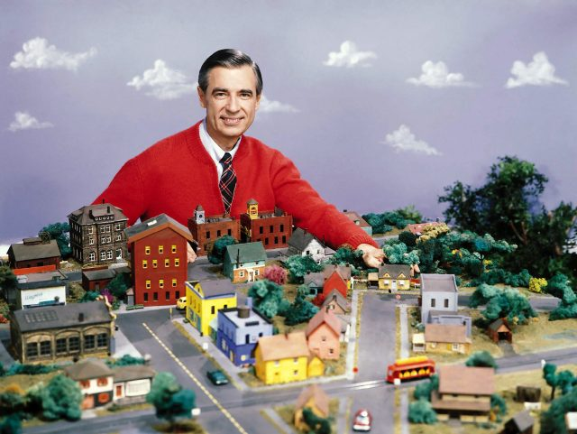 Mr. Rogers poses with his model town